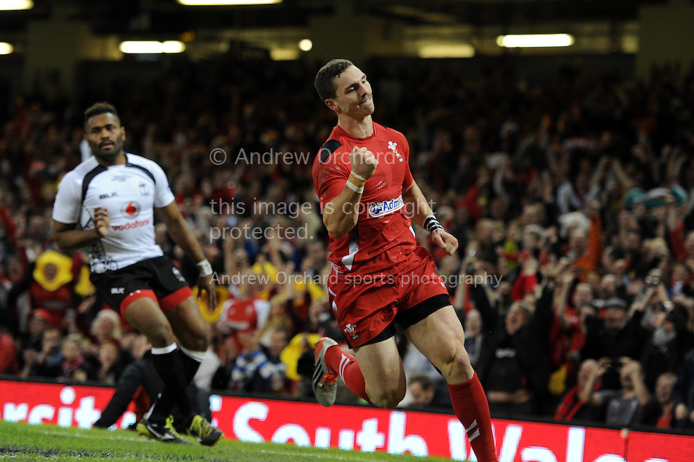 George North of Wales celebrates after he scores his teams 1st try. Dove Men series 2014, autumn international rugby, Wales v Fiji at the Millennium Stadium in Cardiff, South Wales on Saturday 15th November 2014.<br /> pic by Andrew Orchard, Andrew Orchard sports photography.