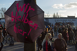 Protesters against the Demolition of the East Side Gallery, the Berlin Wall. Some 25 meters of this section of the wall that mostly came down 23 years ago and marked the end of the cold war are taken away to make way for a new housing development on river Spree, a project called Living Levels, Berlin, Germany,  March 3, 2013. Photo by Imago / i-Images...UK ONLY