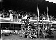 RDS Spring Show at Show Grounds, Ballsbridge, Dublin. Tostal Cp Competition - Horse Jumping..Iris Kellett Riding 'Rusty'.07/05/1954