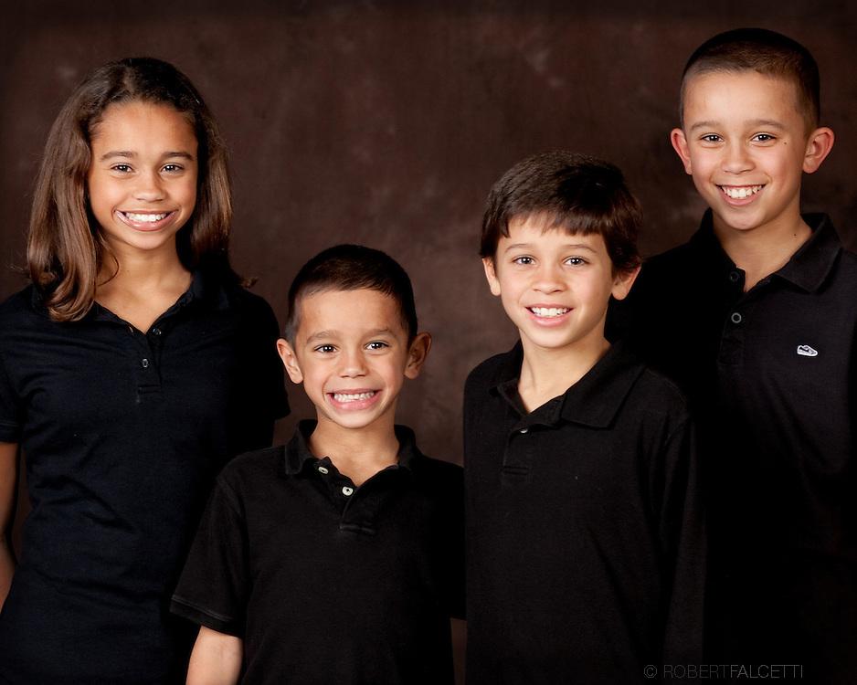 Family Portrait photography Southington, West Hartford, Avon, Connecticut portraits on location West Simsbury, Simsbury, Greenwich, Cos Cobb, Darien, Westport (Photo by Robert Falcetti). .