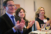 Laura Hamady of Chronicle Security applauds during the Bay Area Corporate Counsel Awards at The Westin San Francisco Airport in Millbrae, California, on March 18, 2019. (Stan Olszewski for Silicon Valley Business Journal)
