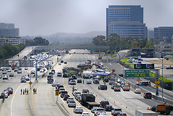 June 30, 2017 - Los Angeles, California, U.S - Police and Firefighters investigate at the site of a twin-engine Cessna 310 airplane crash on on the San Diego (405) Freeway near oh Wayne Airport in Orange County, California, June 30, 2017. (Credit Image: © Ringo Chiu via ZUMA Wire)
