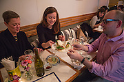 Brooklyn, NY - 26 April 2014. (L to R) Judy Newhouse, Erica Newhouse, and Chris Kasper with a plate of apple avocado buns at Dotory. Kasper went to graduate school with chef Haegeen Kim, and said she used to cook for her friends there.