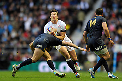 Joel Tomkins (England) is tackled in possession - Photo mandatory by-line: Patrick Khachfe/JMP - Tel: Mobile: 07966 386802 09/11/2013 - SPORT - RUGBY UNION -  Twickenham Stadium, London - England v Argentina - QBE Autumn Internationals.