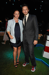 STELLA McCARTNEY and husband ALASDHAIR WILLIS at a party to celebryate the launch of the Spring Summer 2008 adidas collection by Stella McCartney held at the Westway Sports Centre, off Latimer Road, London W10 on 20th September 2007.<br /><br />NON EXCLUSIVE - WORLD RIGHTS