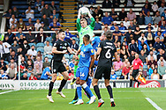 Portsmouth goalkeeper Craig MacGillivray (15) catches this cross during the EFL Sky Bet League 1 match between Peterborough United and Portsmouth at London Road, Peterborough, England on 15 September 2018.
