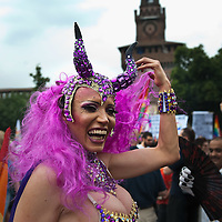 MILAN, ITALY - JUNE 12:  One of the participants to the Gay Pride Milano at the start of the march with the background of Castello Sforzesco on June 12, 2010 in Milan, Italy.  Pride Milano is one of the oldest gay marches in Italy and today's march is against homophobic violence  (Photo by Marco Secchi/Getty Images)