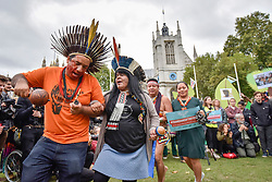© Licensed to London News Pictures. 24/10/2017. London, UK. Indigenous people from South America and Asia take part in a demonstration in Parliament Square as part of the Guardians of the Forest campaign.  They call for land rights, access to climate finance and inclusion of ancestral knowledge in climate strategies ahead of climate talks taking place in Bonn, Germany in November. Photo credit : Stephen Chung/LNP
