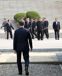 April 27, 2018 - Panmunjom, South Korea - South Korean President MOON JAE-IN meets North Korean leader (DPRK) KIM JONG UN, as he crosses the concrete step and the world's most heavily armed border to greet the South Korean President. (Credit Image: ? Inter-Korean Press Corps via ZUMA Wire)