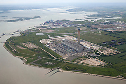 © Licensed to London News Pictures. 26/04/2016. Isle of Grain, Kent, UK. Grain powerstation, London Thamesport and Kingsnorth power station on the River Medway. Photo credit: Martin Apps/LNP