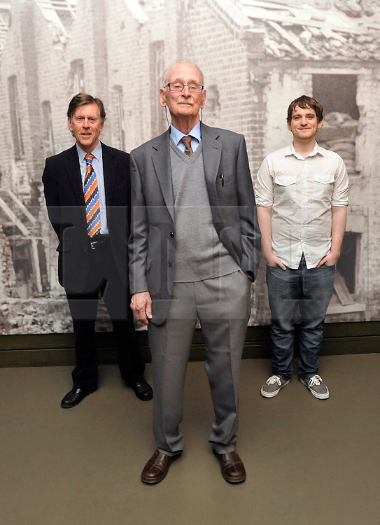 © Licensed to London News Pictures. 04/04/2012. London, UK. Three generations of the Allpress, (L_R) Michael, Harry Allpress (93) and Thomas.  Photo call and preview for the Imperial War Museums new A Family in Wartime exhibition. The exhibition features the life on the Home Front during the Second World War, explored through the eyes of one London based family, the Allpress. Photo credit : Stephen SImpson/LNP