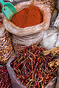 Dried chili peppers and ground chili at Benito Juarez market in Oaxaca, Mexico.