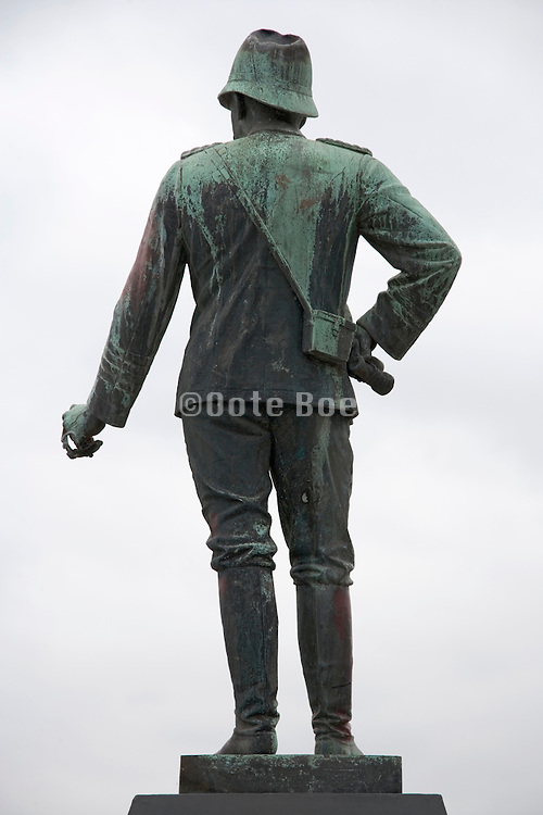 the back of a statue of a soldier with missing sword Germany Hamburg