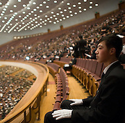 An attendant keeps watch from a balcony during a session of the National People's Congress after a session in the Great Hall of the People. Chinese leaders are trying to improve energy efficiency to reduce both environmental damage and China's reliance on imported oil, which they see as a strategic weakness.