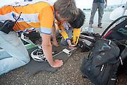 Paul Denissen en Eduard bekijken de meetdata tijdens de testrit. Het Human Power Team Delft en Amsterdam (HPT) traint op de RDW baan in Lelystad met de VeloX2 voor de recordpoging in september. Het HPT hoopt dan in Amerika meer dan 133 km/h te rijden over 200 meter.<br /> <br /> Paul Denissen and Eduard are watching at the data during a test run. Human Powered Team Delft and Amsterdam (HPT) is training at the RDW test track in Lelystad with the VeloX2 for the record attempt in september.