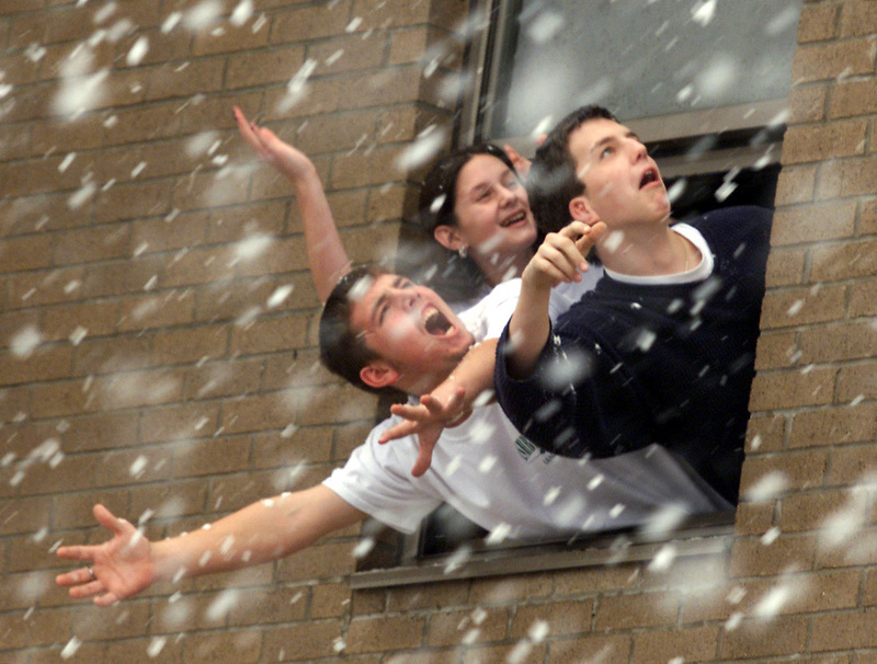Donnie Kistler, left, Lisa Clear, middle, and Buck White reach for snow out a window at Ashbrook High Friday afternoon. (photo..>Andrew Shurtleff).Please feel free to improvise on the cutline.