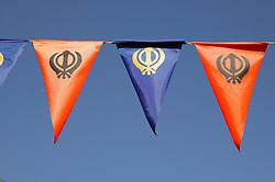 Sikh symbol on flags outside a Gurudwara,