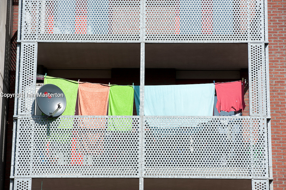 Satellite dish and laundry drying on balcony in modern apartment buildings in Java Island district of Amsterdam The Netherlands