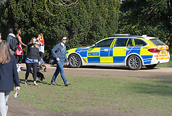 © Licensed to London News Pictures 27/02/2021.        Greenwich, UK. A police car on patrol. People out and about during a third national Coronavirus lockdown enjoying the sunny weather in Greenwich Park, London. Photo credit:Grant Falvey/LNP
