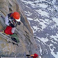 BAFFIN ISLAND, CANADA. John Catto films Alex Lowe on Great Sail Peak.
