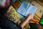 Tabasum Khatun, 14, is studying the Holy Koran in the Madrassa of Algunda village, pop. 1000, Giridih District, rural Jharkhand, India.