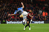 Callum Wilson (13) of AFC Bournemouth and Huddersfield Town defender Christopher Schindler (26) during the Premier League match between Bournemouth and Huddersfield Town at the Vitality Stadium, Bournemouth, England on 4 December 2018.