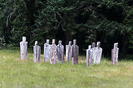 """Wooden """"People"""" in a field near Ganges on Salt Spring Island, British Columbia, Canada."""