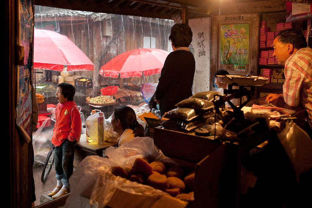 Waiting out a downpour in the dry goods shop in the center of Heshun old town.