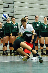 22 September 2015:  Diving for the ball, a Titan player almost dives into the corner judge during an NCAA womens division 3 Volleyball match between the Augustana Vikings and the Illinois Wesleyan Titans in Shirk Center, Bloomington IL