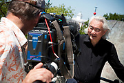 """Michio Kaku, presenter of """"Physics of the impossible at The Greenwich Obsevatory, London, UK. Steve Bowers filming Michio"""