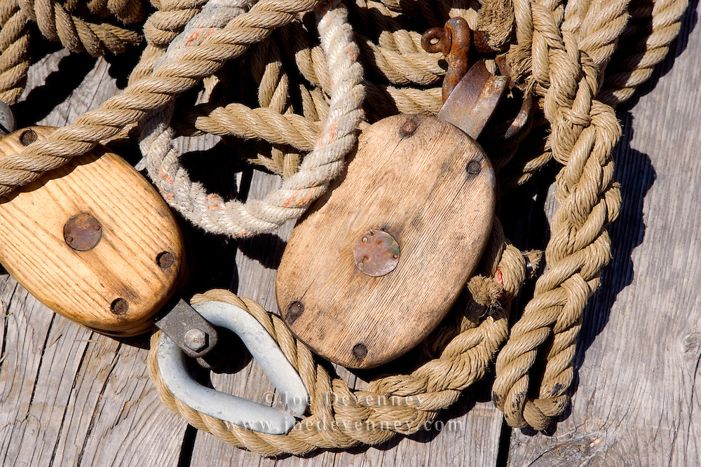 Ropes from a commerical fishing vessel with a block and tacle lying on a dock. Rockland, Maine