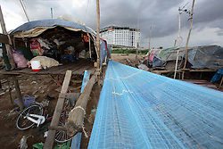 Muslim fisher families and their nets that make their temporary homes across the river from Phnom Penh. Cambodia.