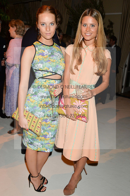 Left to right, PETRA PALUMBO and IRENE FORTE at a dinner hosted by Cartier in celebration of The Chelsea Flower Show held at The Hurlingham Club, London on 19th May 2014.