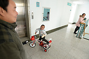 WUHAN, CHINA - NOVEMBER 16: (CHINA OUT) <br /> <br /> 3D-Printed Hand Completed<br /> <br /> A child wears 3D-printed hand while riding a small bicycle at Wuhan Third Hospital on November 16, 2015 in Wuhan, Hubei Province of China. A child, a farmer Liu Taos son, fell into a fiery pit where straws was burning when he was only three years old. Left ear and left hand got injured heavily that the left hand had to be cut. While a phone in May this year from Wuhan Third Hospital gave them hope that the lost left hand could be replaced by 3D-printed hand and luckily it made success on the child finally. <br /> ©Exclusivepix Media