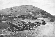 Russo-Japanese War 1904-1905:  203 Metre Hill on the day of its capture by the Japanese. Russian soldiers collecting cartridges from the dead before burial, November 1904