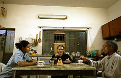Alyaa Abdul Hassan Abbood, 23, a translator, talks with her parents, Baghdad, Iraq, Sept. 29, 2003. Abbood works with the U.S. military to mediate as Iraqi civilians come in to receive monetary compensation for damages done by American troops in Baghdad.