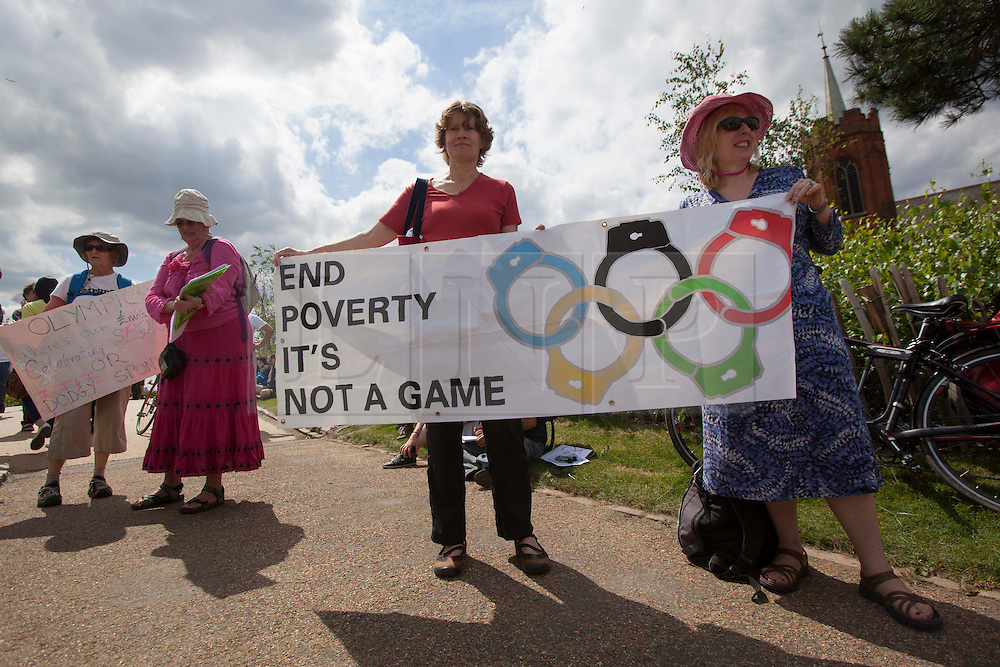 © licensed to London News Pictures. London, UK 28/07/2012. Anti-Olympics protesters gathering in Mile End Park to march to Victoria Park in order to protest against the greed of the Olympic sponsors. Photo credit: Tolga Akmen/LNP