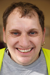 Portrait of man with a mild learning disability working as a factory cleaner,helped into employment by the Ready 4 Work team, Nottinghamshire County Council