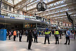 © Licensed to London News Pictures. 17/04/2021. London, UK. Travellers and rail staff take part in a national one minute silence at Waterloo train Station for the Duke of Edinburgh who died on 9th April 2021. His funeral is being held today. His funeral took place today at Windsor Castle. Photo credit: Ray Tang/LNP