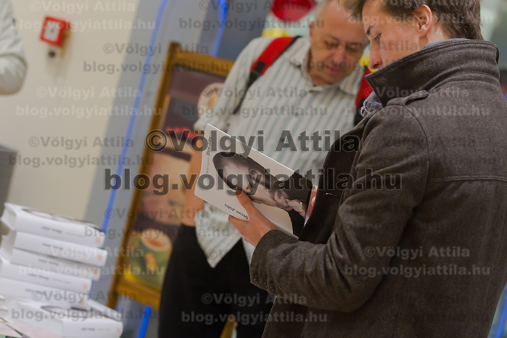 A copy of the Steve Jobs biography written by Walter Isaacson is in the hands of a customer during the premiere of the Hungarian translation being published in Budapest, Hungary on November 28, 2011. ATTILA VOLGYI