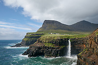Gásadalur located on the west side of Vágar, Faroe Islands. The village sits high and with a sheer drop where the waterfall Múlafossur plunges into the ocean.