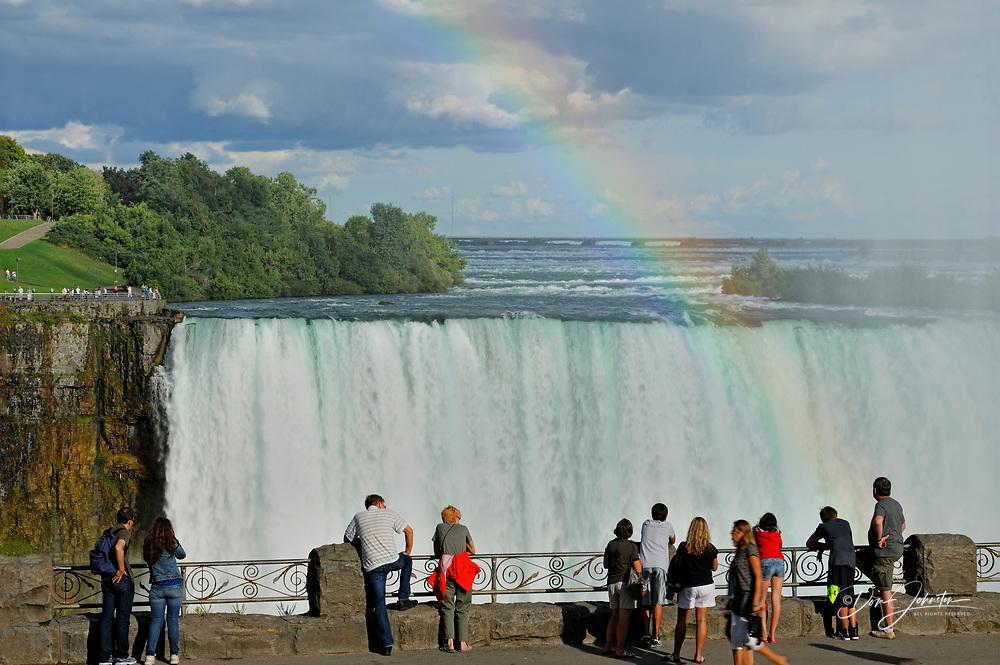Tourists gather to view the Canadian Falls, Niagara Falls, Ontario, Canada