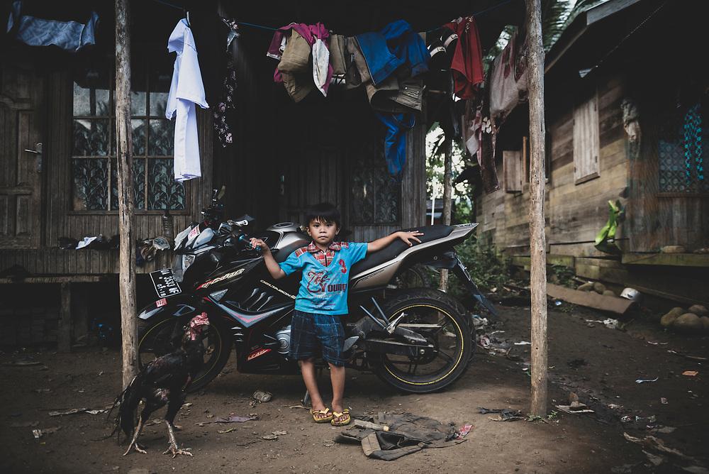South Kalimantan, Indonesia - February 28, 2017: Arga, age 5, in the village of Loklahung, near Loksado, South Kalimantan, Indonesia.