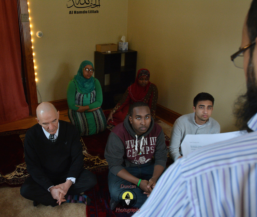 BRUNSWICK, Maine -- 1/29/16 -- A group of Muslims prays regularly at Bowdoin College under tutelage of one of the professors. Some are students others faculty and friends. Reza Jalali, seated at left, is a regional leader. Photo by Roger S. Duncan for The Forecaster.