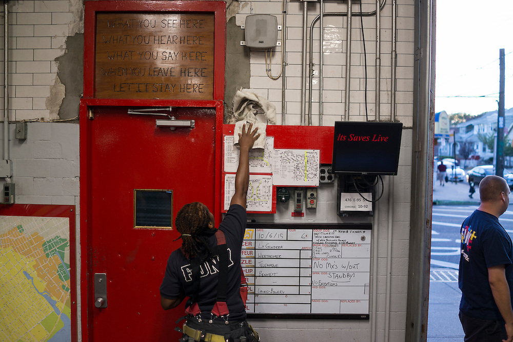 Firefighter Melissa Bennett, left, at the quarters of Engine 257, 1361 Rockaway Parkway, Brooklyn, NY on Tuesday, Oct. 6, 2015.<br /> <br /> Andrew Hinderaker for The Wall Street Journal<br /> NYFDNY