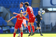 Cardiff City's Kieffer Moore (10) competes for a high ball with Nottingham Forest's Scott McKenna (26) during the EFL Sky Bet Championship match between Cardiff City and Nottingham Forest at the Cardiff City Stadium, Cardiff, Wales on 2 April 2021.
