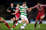 Celtic midfielder James Forrest (#49) takes on Aberdeen defender Anthony O'Connor (#15) during the Scottish Cup final match between Aberdeen and Celtic at Hampden Park, Glasgow, United Kingdom on 27 November 2016. Photo by Craig Doyle.