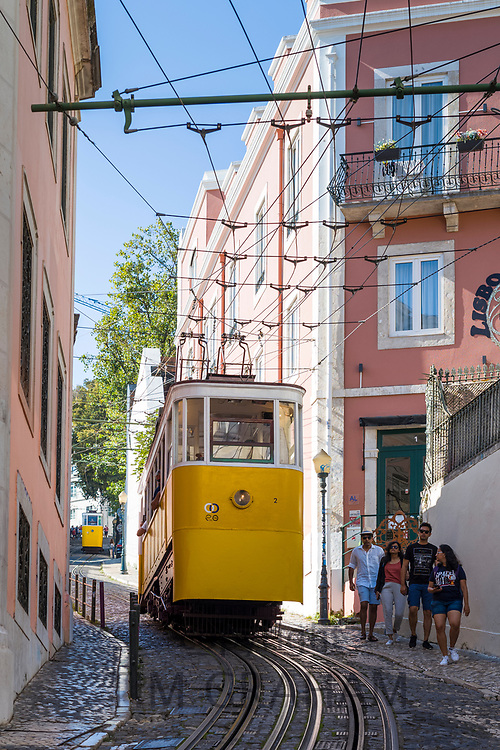 Gloria Funicular - Elevador Gloria - for local people and tourists on tram tracks up steep hill links Barro Alto with Chiado in Lisbon, Portugal
