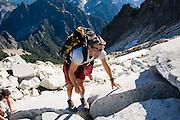 HIkers climb to the summit of Vesper Peak, North Cascades, Washington.