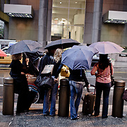 People waiting the bus under the rain